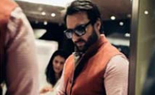 Saif Ali Khan looking at some elegent shoes