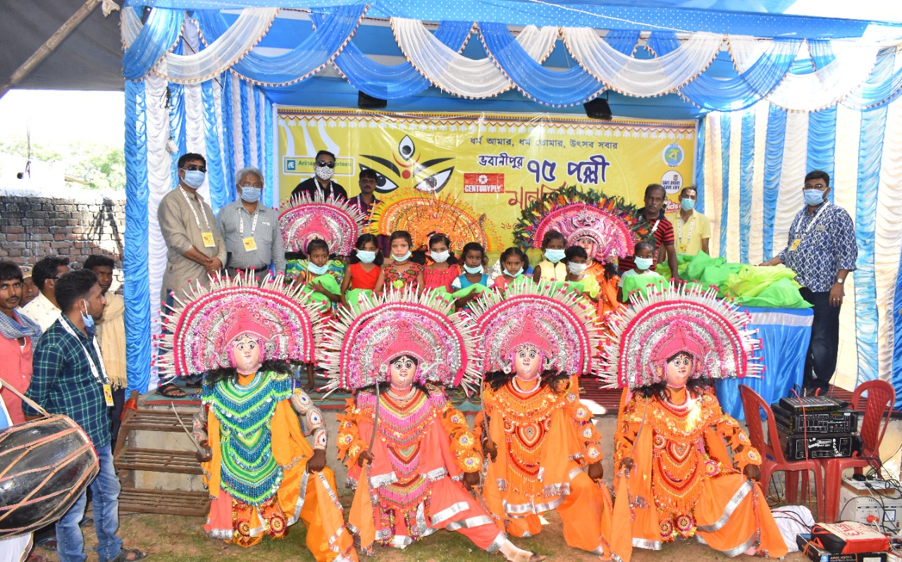 Bhowanipur 75 Palli puja committee  Celebrates World Daughter's Day by distributing  clothes to kids of 250 Chhau Dancers at Charida Village in Purulia
